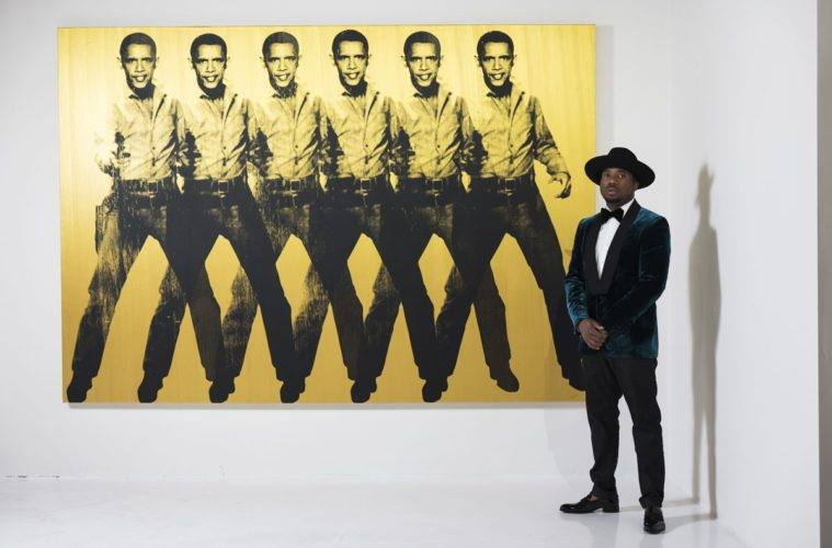 Knowledge Bennett standing next to his art piece, Obama Cowboy, Six-Shooter (2012).