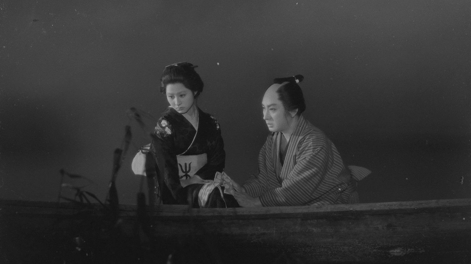 "Black and white still image of two people from the film ""A Story in Chikamatsu"""