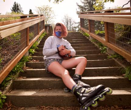 Carly Lant, a Multidisciplinary Studies major, takes a break from rollerblading around the South Hill neighborhood.