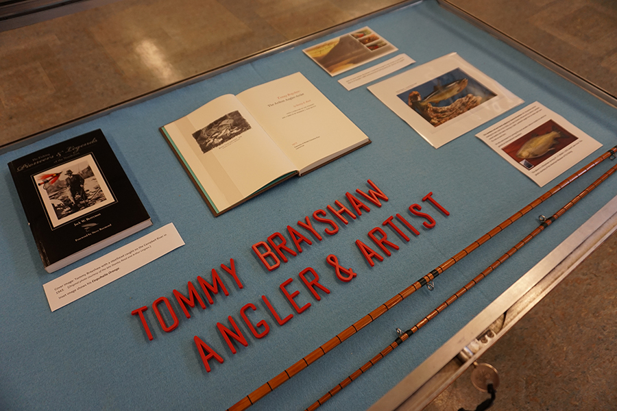 Tommy Brayshaw angler and artist display case with books and rod made by Brayshaw