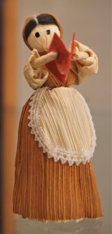 Cornhusk doll with red book