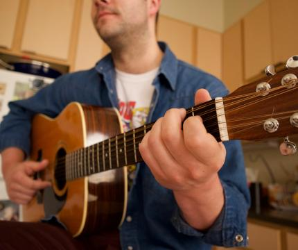 Max Hunt, an English major from Oakland, California, plays a tune on his twelve-string guitar.
