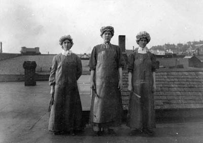 "Three women fish cannery workers standing on a building roof top. Back caption: 'Aunt Clara & friends on top of P.A.F. roof."" & Clara Weaver, Florence Pettibone, Carrie Salvo.' (GB465)"