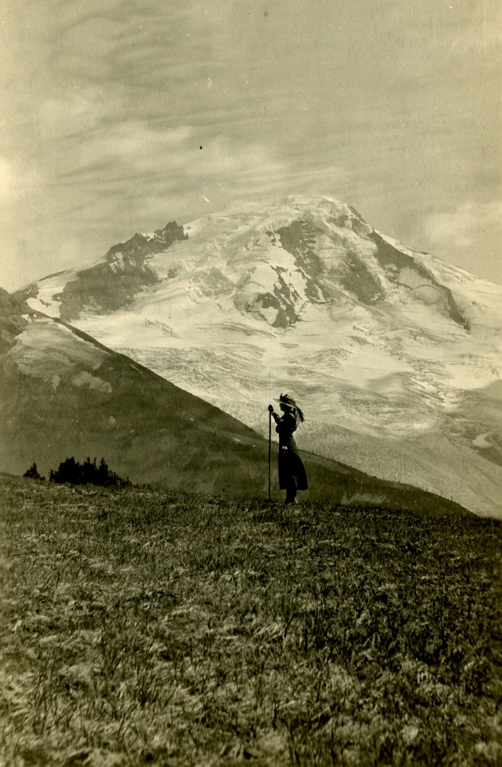 Woman standing in front of a mountain