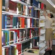 Person shelving materials