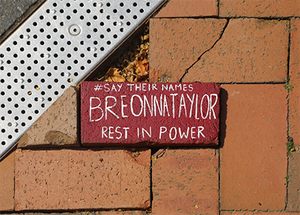 Painted brick with a message honoring Breonna Taylor, who would have turned 27 on June 5, 2020.