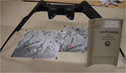 Stereoscope used to view aerial flight images.