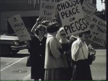 """Anti-nuclear protestors march in downtown Bellingham. Still from """"If The Bomb Survives, Can We?"""" Airdate June 1, 1962. KVOS Channel 12 Films, CPNWS."""